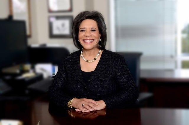 Debra Plousha Moore at desk